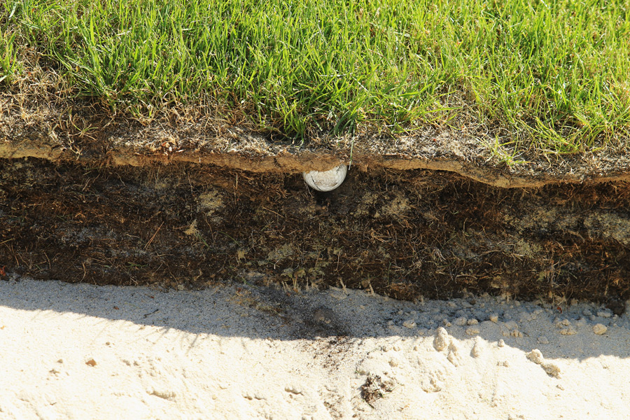 Lee Westwood's ball buried in the face of a bunker at the BMW PGA Championship.