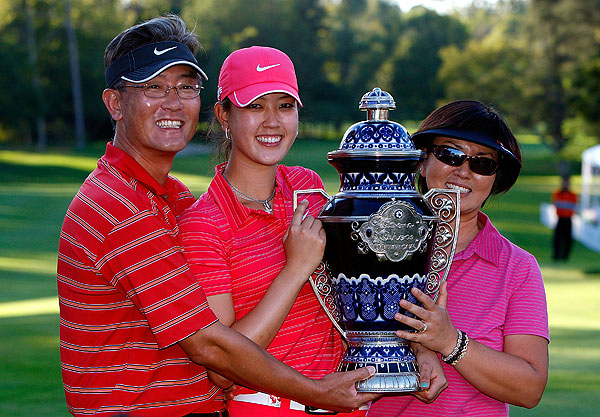 won the LPGA Tour's Lorena Ochoa Invitational on Sunday in Mexico. Afterward, she celebrated with her parents.