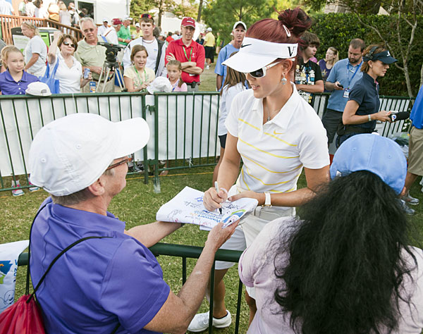 Michelle Wie debuted her new red hairstyle at the 2011 NW Arkansas Championship.