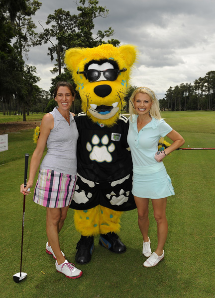 McMurry and Angie Oberholser with the Jacksonville Jaguar's mascot, Jaxson De Ville.