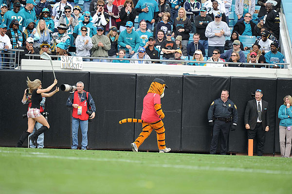 During a timeout at the Houston Texans/Jacksonville Jaguars football game Sunday, a blonde with a golf club chased a Tiger mascot wearing a red shirt and Nike hat.