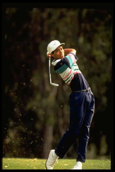 Tiger hitting an iron shot.
