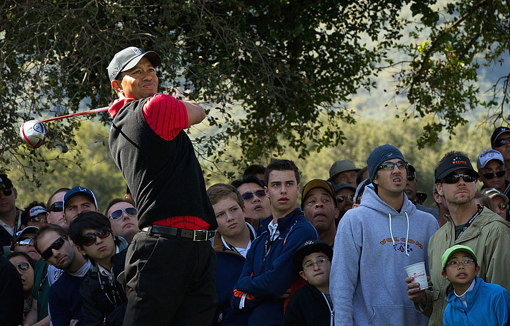 Woods dropped back into a tie for the lead after he couldn't match Johnson's birdie on the par-5 13th.