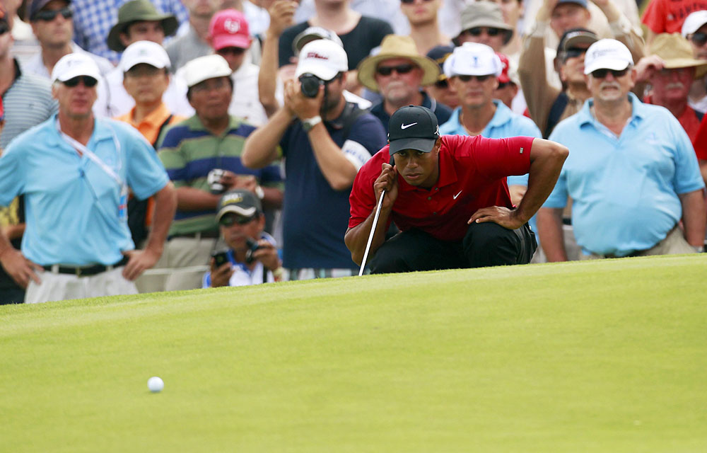 """Two holes on the back nine today, and I putted awful yesterday, or I would have been right there,'' Woods said."
