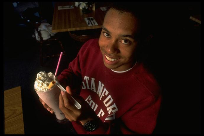 Tiger Woods drinking a milkshake.