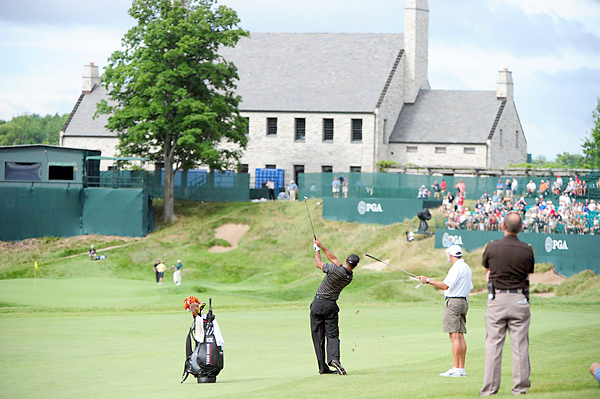 Whistling Straits hosted the PGA Championship for the first time in 2004. Woods finished T24, and Vijay Singh won in a three-way playoff.