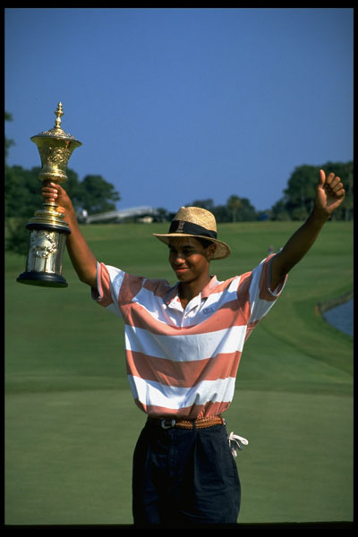 Tiger Woods holding the trophy after winning the 1994 U.S. Amateur Championship at TPC at Sawgrass, Stadium Course in Ponte Vedra, Fla., August 1994.
