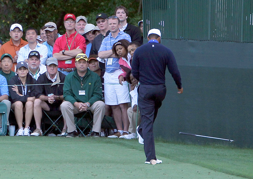 Woods's frustration boiled over on the par-3 16th. After a poor tee shot, Woods dropped his club and then kicked it.