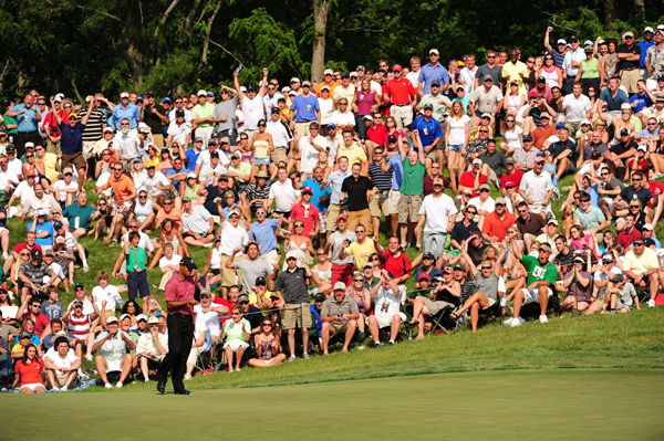After a sloppy bogey on 16, Woods hit his second shot to nine feet on 17 and drained the putt for birdie.