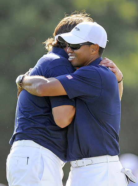 Woods and Mickelson celebrated after Johnson and Kuchar secured a half point.