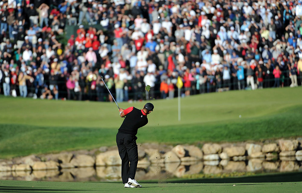 After Johnson hit his approach shot on 18 to about 15 feet, Woods stuck his second shot to six feet to set up the winning putt.