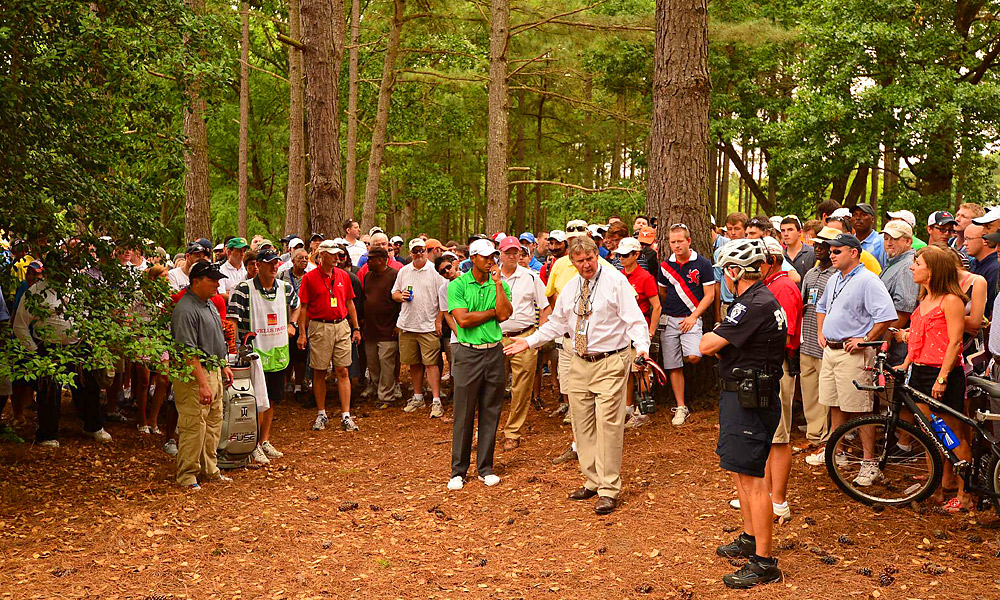 Fighting to make the cut on Friday at the Wells Fargo Championship, Tiger Woods hooked his drive on the fifth hole into the trees. After searching, the ball was nowhere to be found. Just before heading back to the tee, a spectator told the rules official that he had seen the ball land, but that it had disappeared by the time he got to the spot. Based on that evidence alone, the official ruled that the ball had been pocketed by a fan and awarded Woods a free drop, saving him two precious strokes.