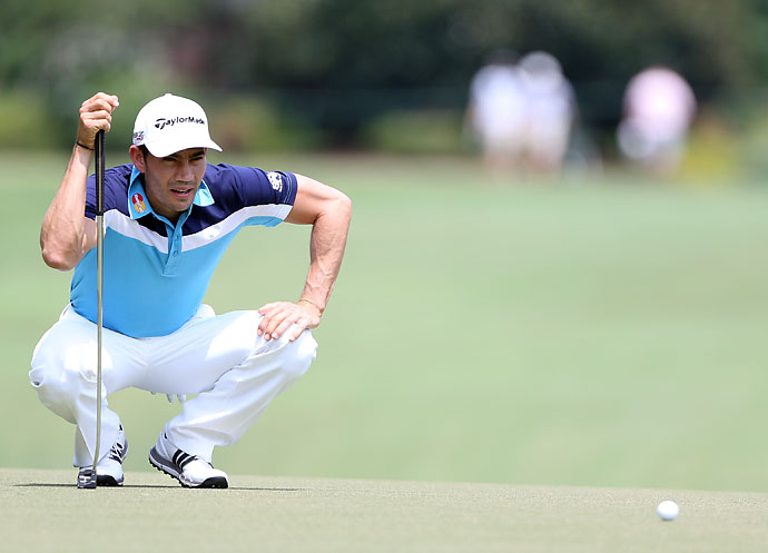 He doesn't get as low as he used to: Camilo Villegas lines up a putt on the first hole during the final round of the Wyndham Championship at Sedgefield Country Club on August 17, 2014