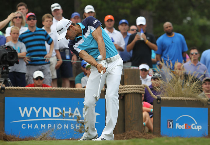 Camilo Villegas plays his tee shot on the 16th hole during the final round of the Wyndham Championship at Sedgefield Country Club on Sunday.