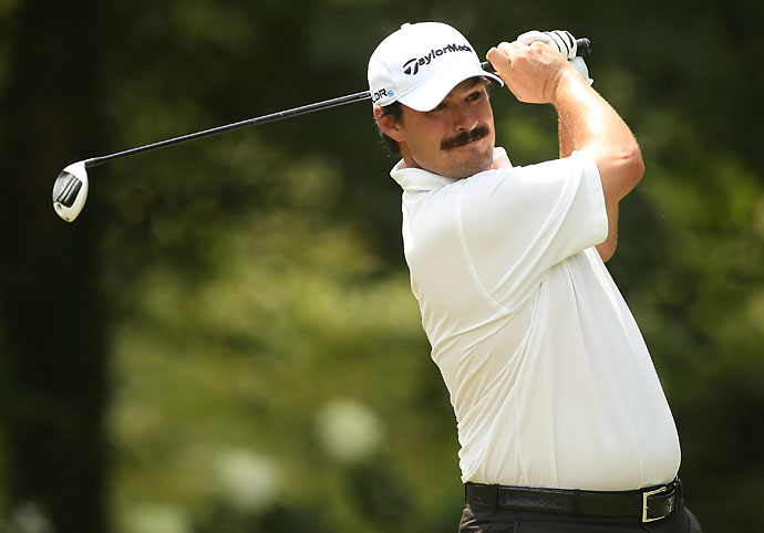 Better work on the mustache, Rickie Fowler. Johnson Wagner channels his inner Tom Selleck while playing his tee shot on the eighth hole during the final round of the Wyndham Championship at Sedgefield Country Club on Sunday. Wagner finished T38.