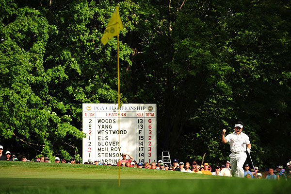 As the scoreboard indicates, Yang was tied with Tiger Woods at six under until he holed this chip for eagle on the par-4 14th.