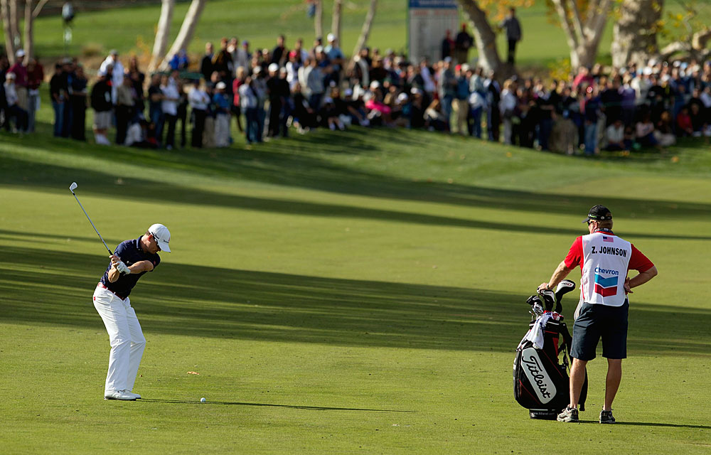 Johnson birdied two of the three par 5s on the back nine, but it wasn't enough to beat Woods.