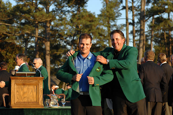 Phil Mickelson, the 2004 and 2006 Masters champion, helped Johnson put on the green jacket.