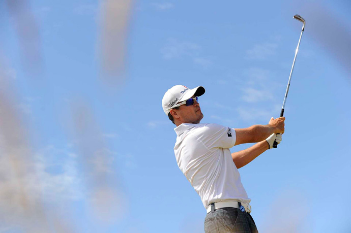 Woods is three strokes behind leader Zach Johnson, who opened with a five-under 66.