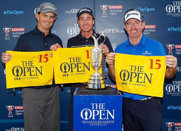 Australians Greg Chalmers, Brett Rumford and Rod Pampling pose for a photo with their flags after qualifing for the 2014 British Open at St. Andrews with fourth, third and second place finishes respectively.