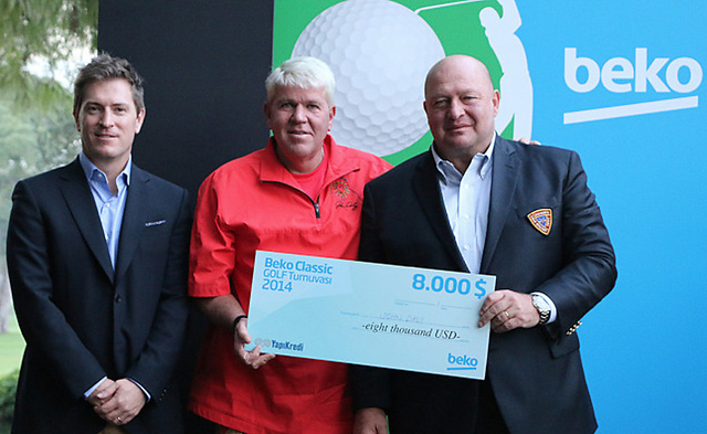 John Daly with his $8,000 winning check after his victory at the Beko Classic in Turkey on Saturday.