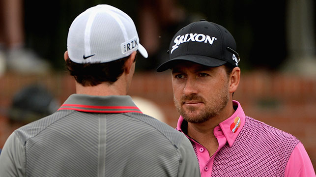 Rory McIlroy of Northern Ireland talks with Graeme McDowell of Northern Ireland on the first tee during the first round of the 114th U.S. Open at Pinehurst Resort & Country Club.