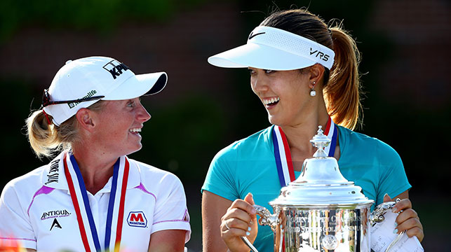 Stacy Lewis of the United States talks to Michelle Wie of the United States after Wie won the 69th U.S. Women's Open at Pinehurst Resort & Country Club, Course No. 2 on June 22, 2014 in Pinehurst, North Carolina.