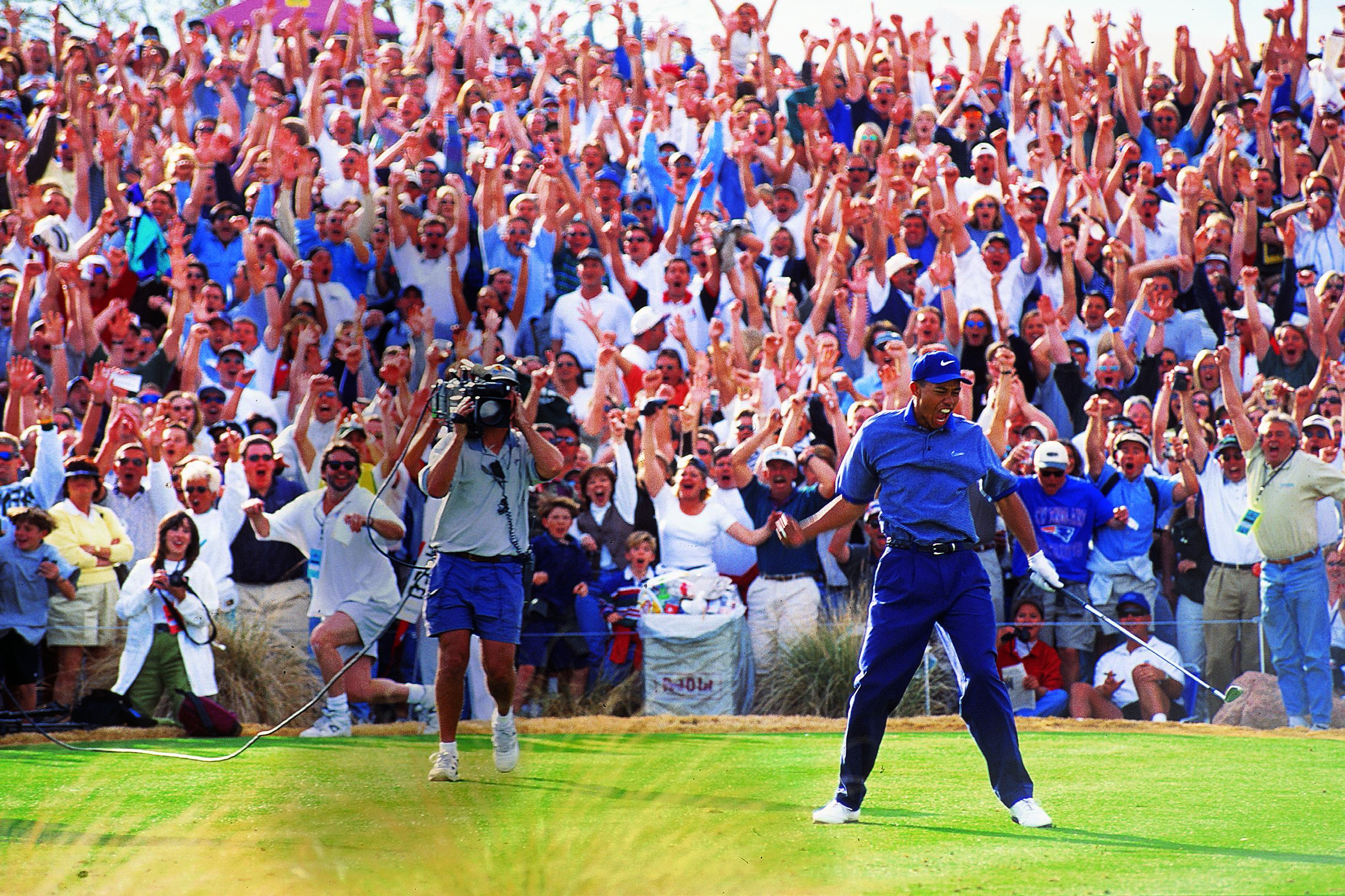 Tiger Woods celebrates after his hole-in-one at the 1997 Phoenix Open.