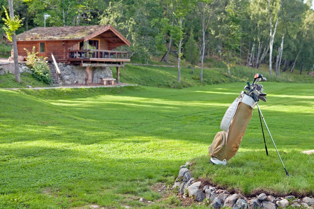 A view of the hunting lodge and one of six tee boxes.