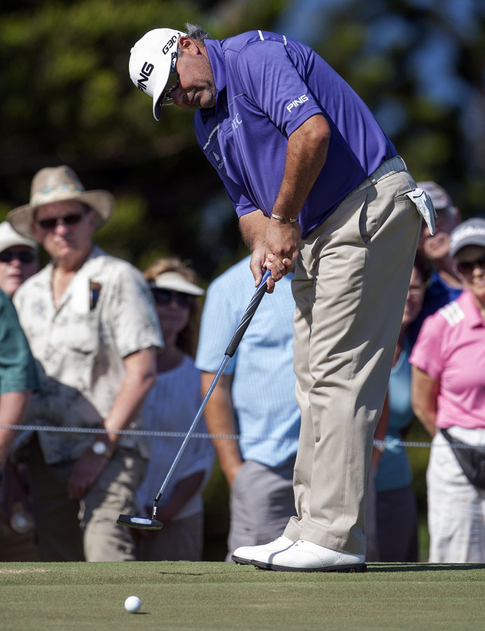 Angel Cabrera putts on the third green during his 2-under 71 Friday.