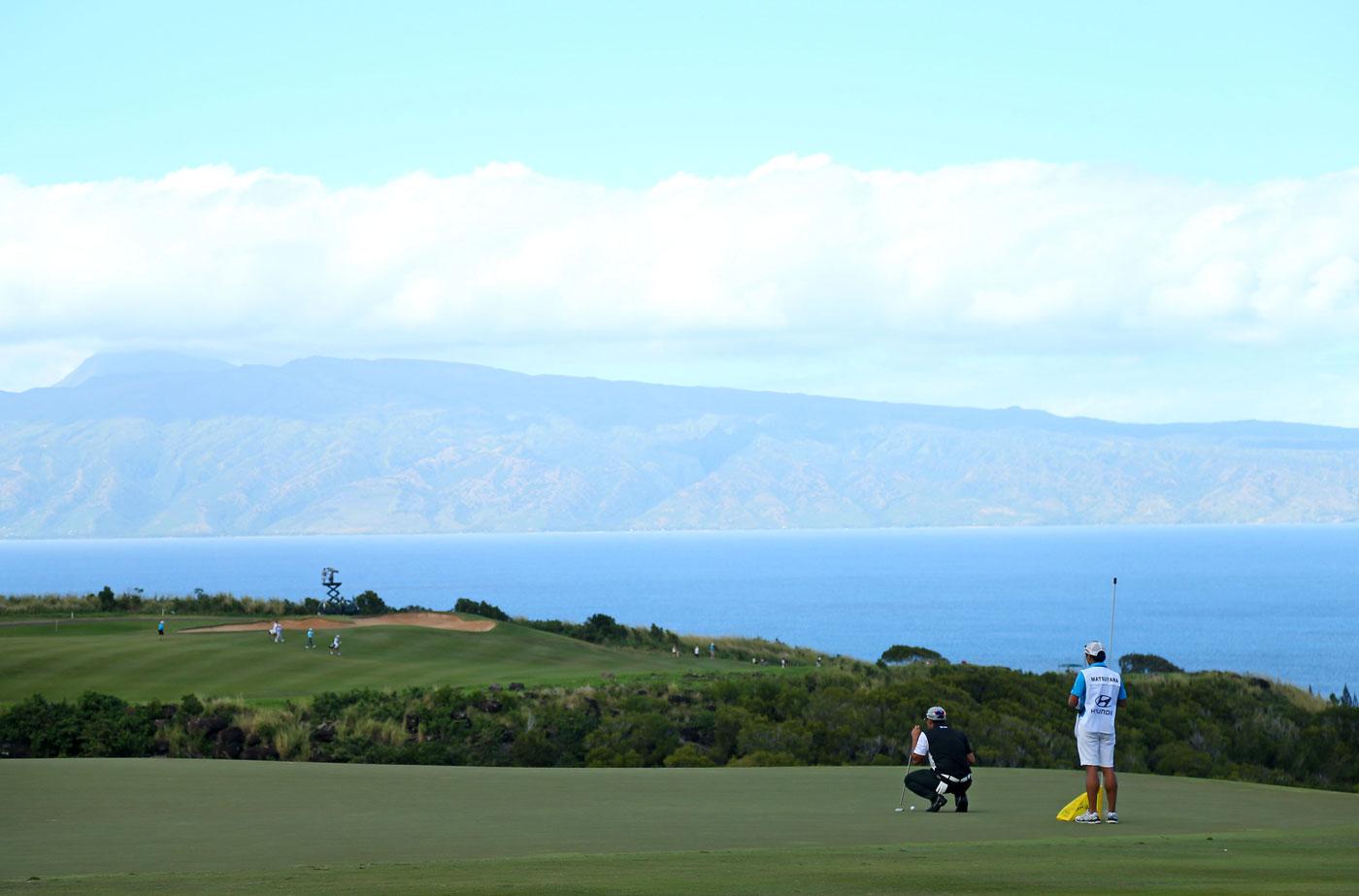 Hideki Matsuyama lines up a putt on the fifth green.