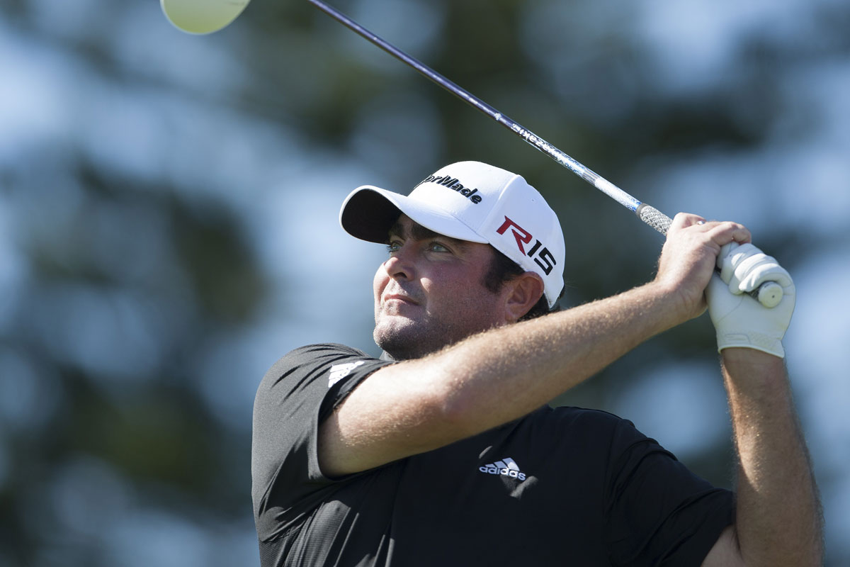 Steven Bowditch watches his shot off the third tee. He shot an opening-round 69.