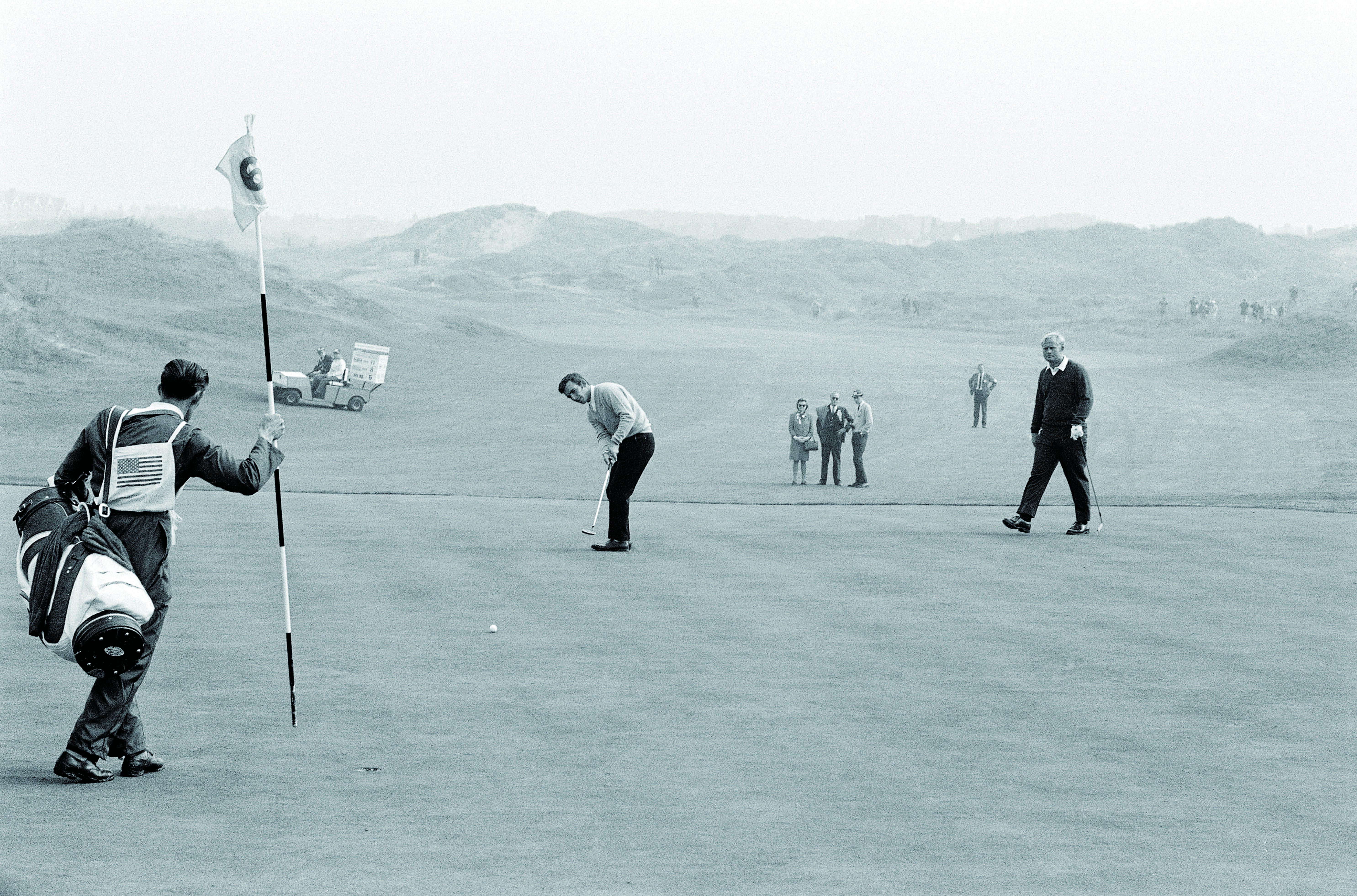 Tony Jacklin and Jack Nicklaus at the 1969 Ryder Cup at Royal Birkdale. The Cup ended in a tie that year when Nicklaus conceded a missable putt to Jacklin, a sportsmanship move for the ages.