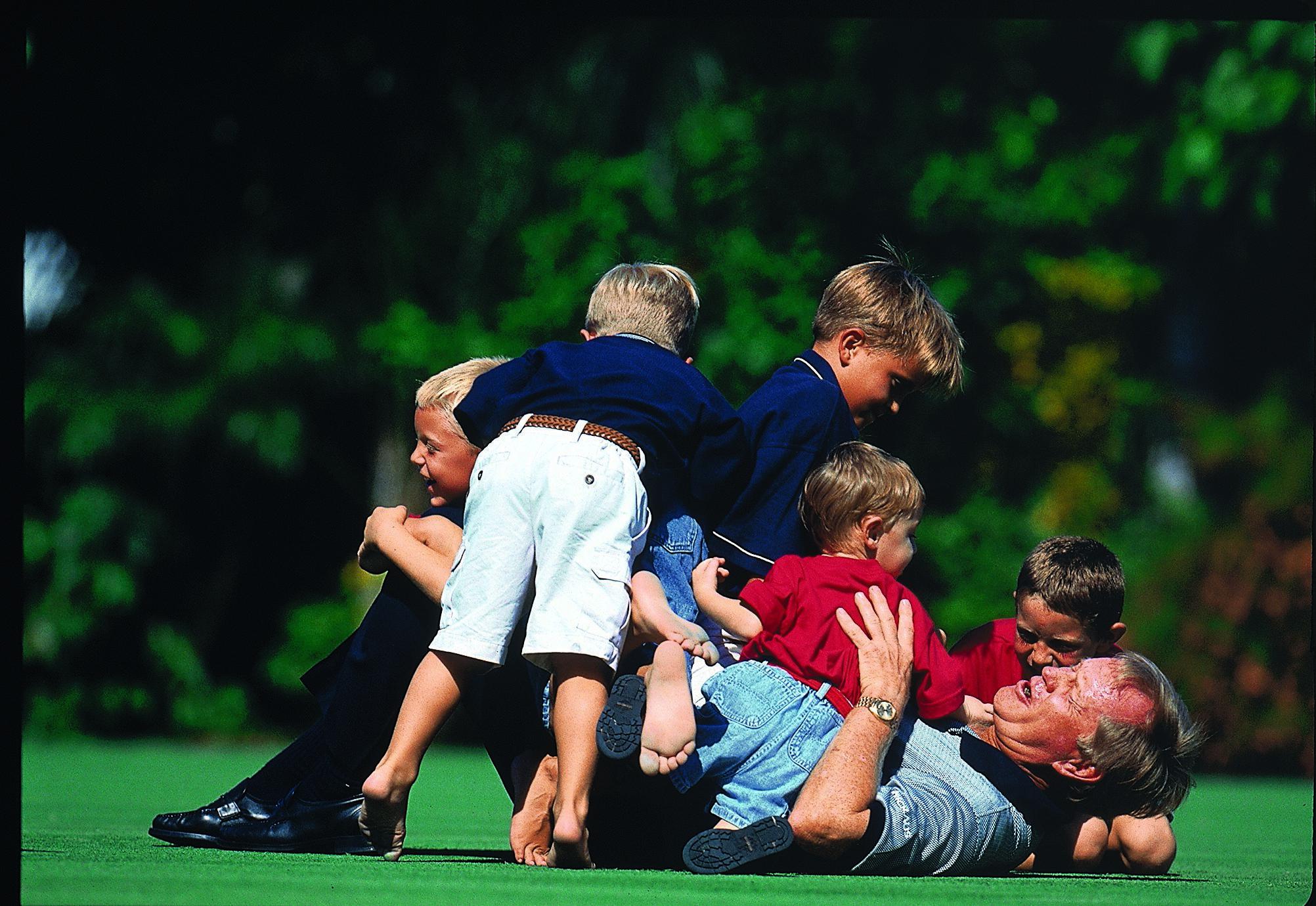Hop on Grandpop? Jack with his grandchildren in 1998.