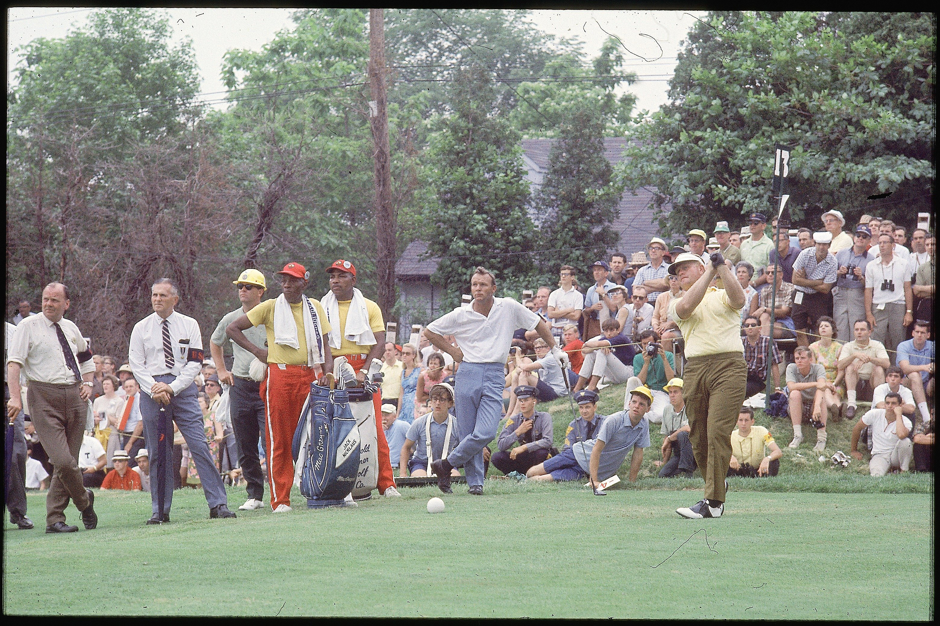 Jack Nicklaus driving as Arnold Palmer looks on at the 1967 U.S. Open