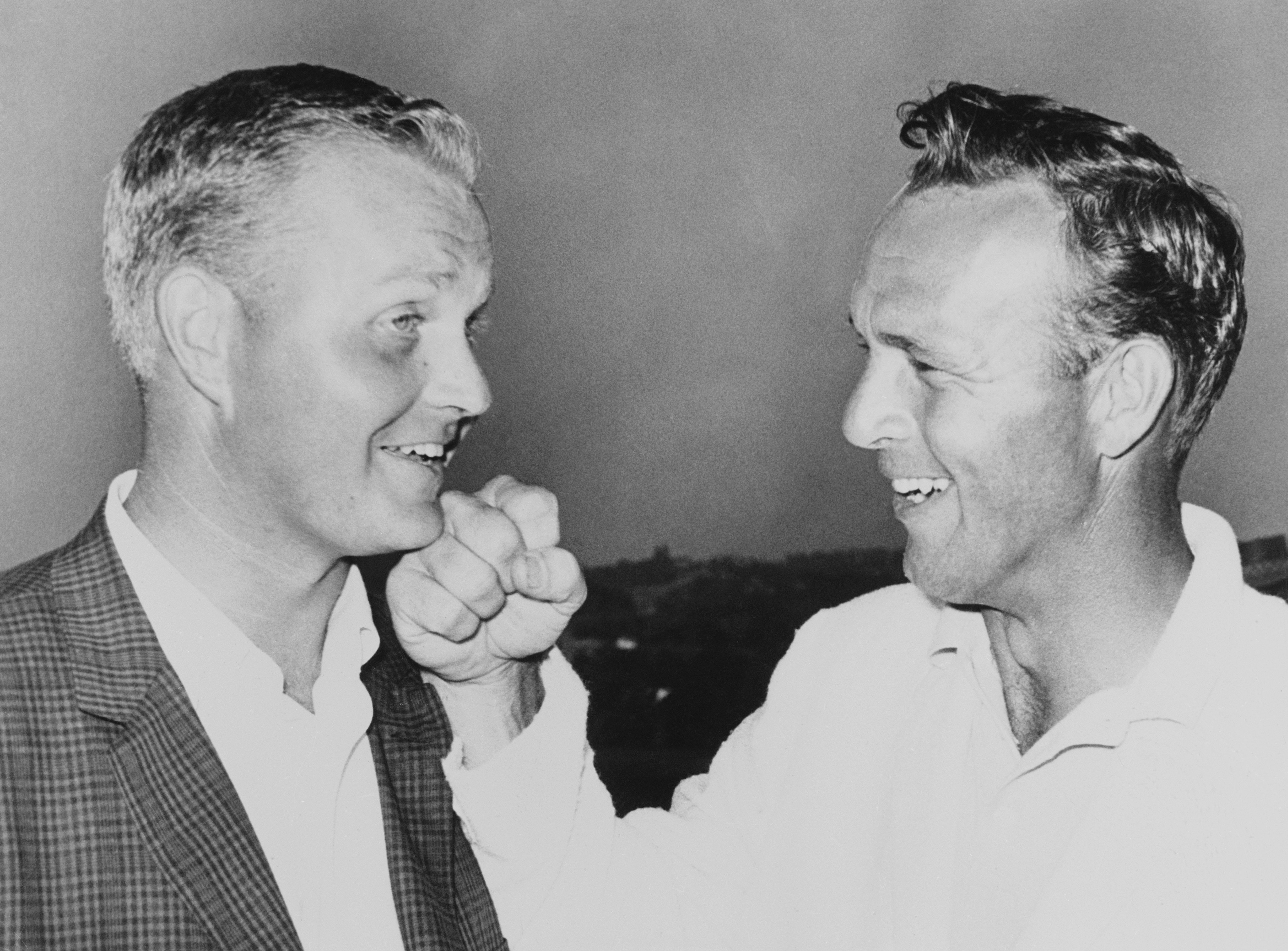 Arnold Palmer playfully punches the chin of Jack Nicklaus after Nicklaus won the 1962 U.S. Open at the Oakmont Country Club in a playoff.