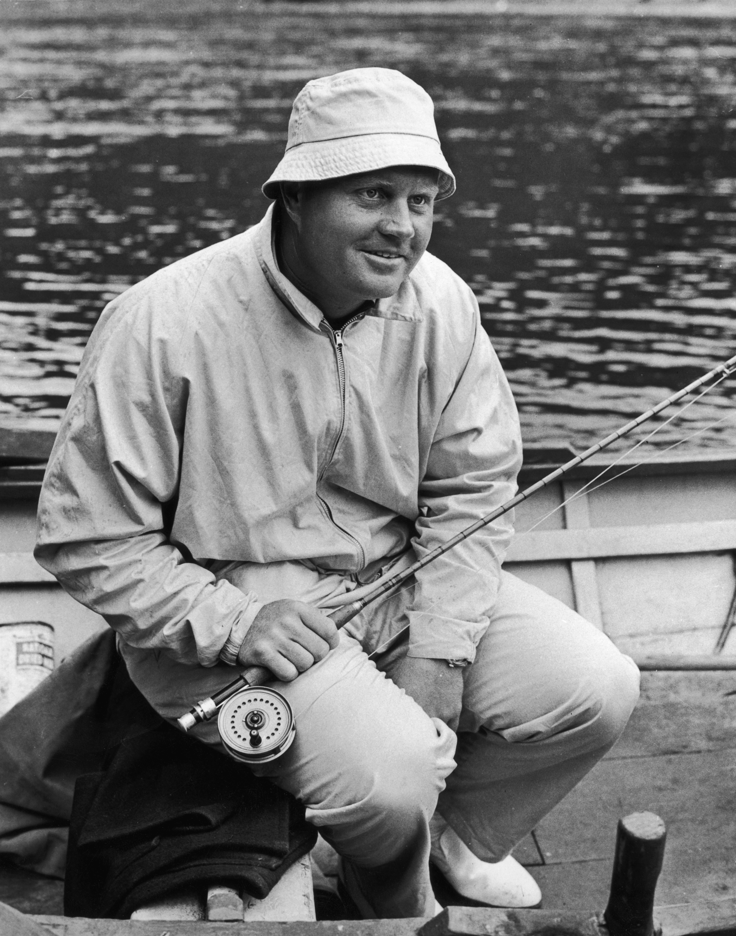 American golfer Jack Nicklaus tries his hand at fishing on the Birnam Hotel stretch of the River Tay, near Dunkeld in Perthshire, Scotland, in 1968.