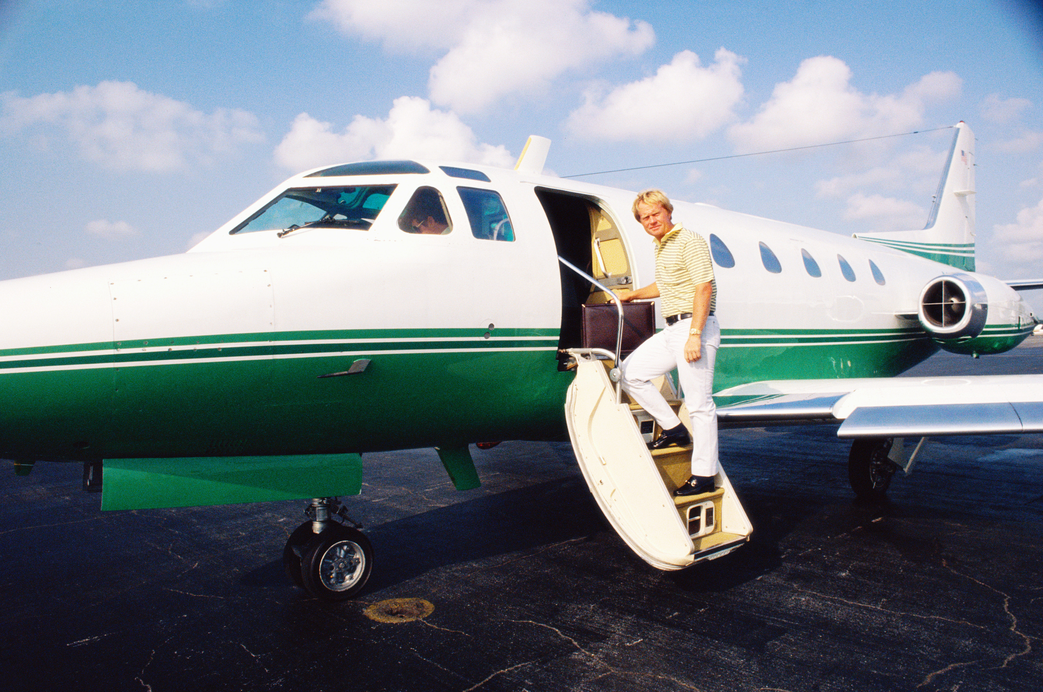 Jack Nicklaus of the USA boarding his plane (undated).