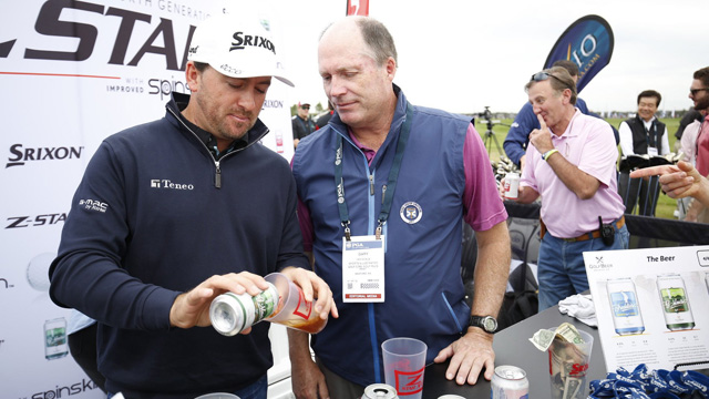 Graeme McDowell pours Gary Van Sickle a G-Mac Pale Ale at Demo Day.