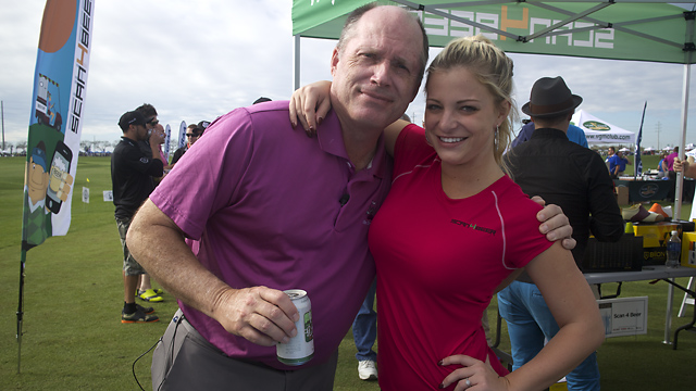 Gary Van Sickle finds a beer at the end of a long day hitting balls, thanks to Scan4Beer's Nicole Hampton.
