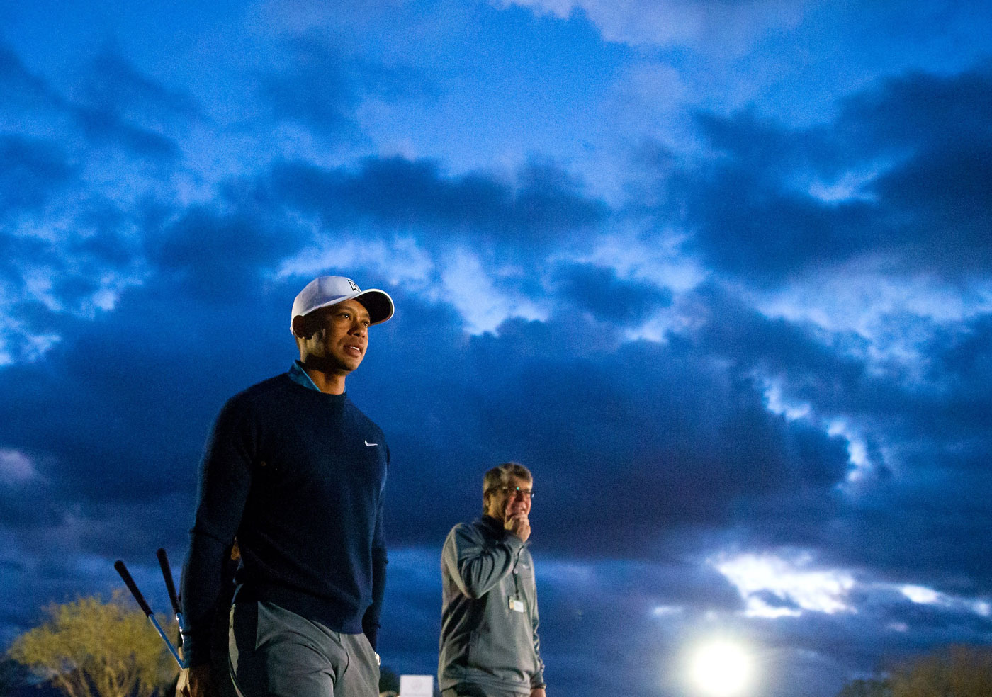 Tiger Woods walks to the driving range before his practice round Tuesday at the Waste Management Phoenix Open.