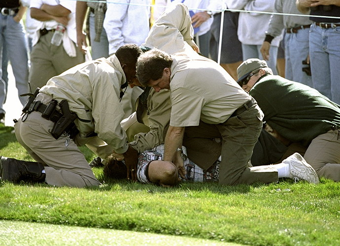 An unruly fan is handcuffed by police at the 1999 Phoenix Open.