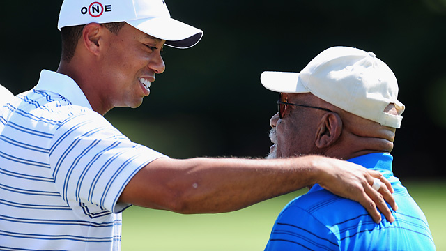 Tiger Woods and Charlie Sifford during a practice round at the 2009 Bridgestone Invitational.