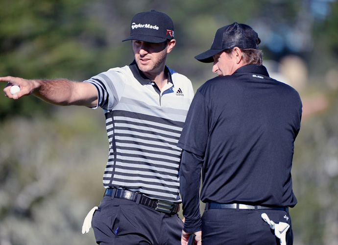 Dustin Johnson and hockey legend Wayne Gretzky wait on the fourth hole during the third round of the AT&T Pebble Beach National Pro-Am at the Pebble Beach Golf Links on February 14, 2015 in Pebble Beach, California.