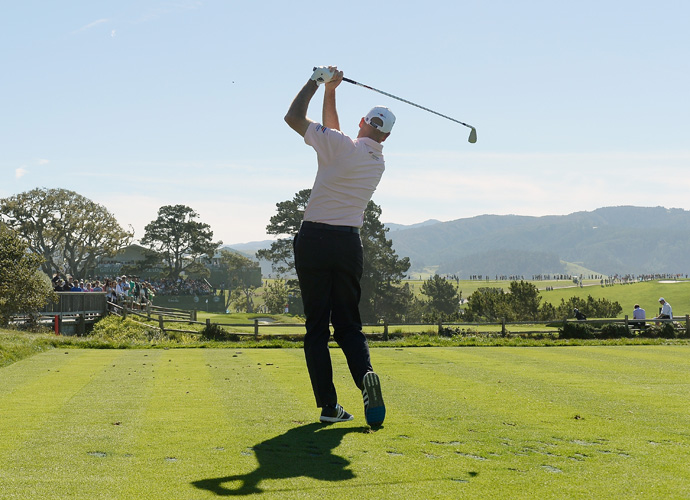 Jim Furyk hits his tee shot on the fifth hole during the third round of the AT&T Pebble Beach National Pro-Am. Jim Furyk made huge gains during round three and sits atop the leaderboard at -18.