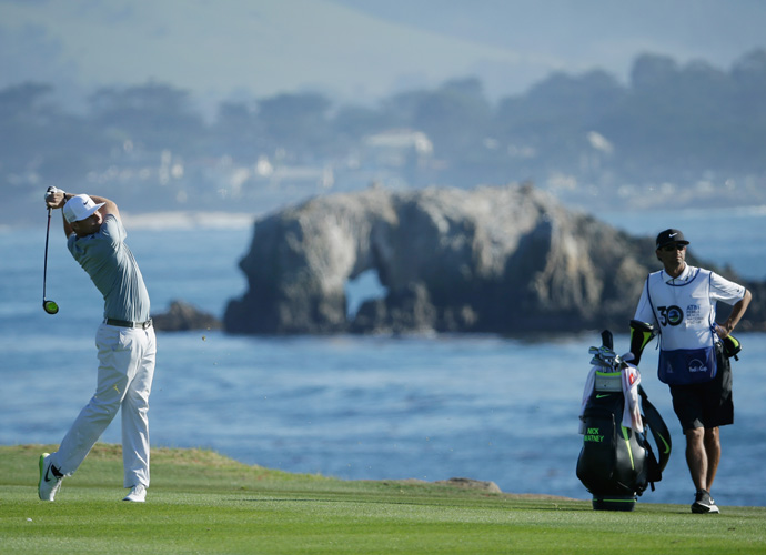 Nick Watney watches his second shot on the 18th hole during the third round of the AT&T Pebble Beach National Pro-Am. Watney moved up 10 spots to share third with Brandt Snedeker (-16).
