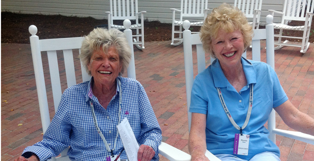 In this photo taken June 17, 2014, Rhonda Glenn, right, sits on the patio at Pinehurst Resort in Pinehurst, N.C., with longtime friend and former U.S. womenís amateur champion Barbara Romack.
