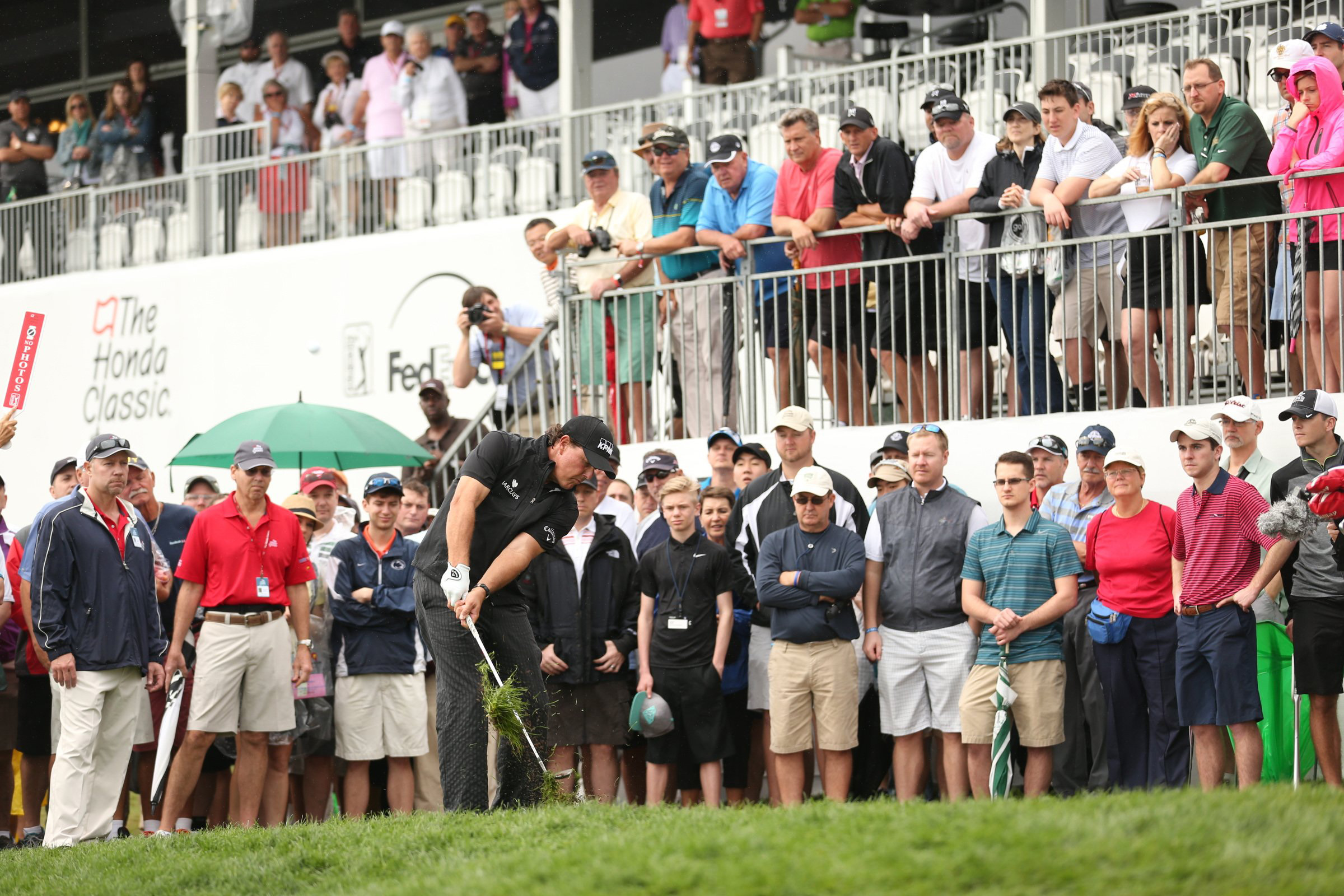 Phil Mickelson takes a healthy divot Saturday at PGA National. Mickelson got himself in the mix on Saturday morning.