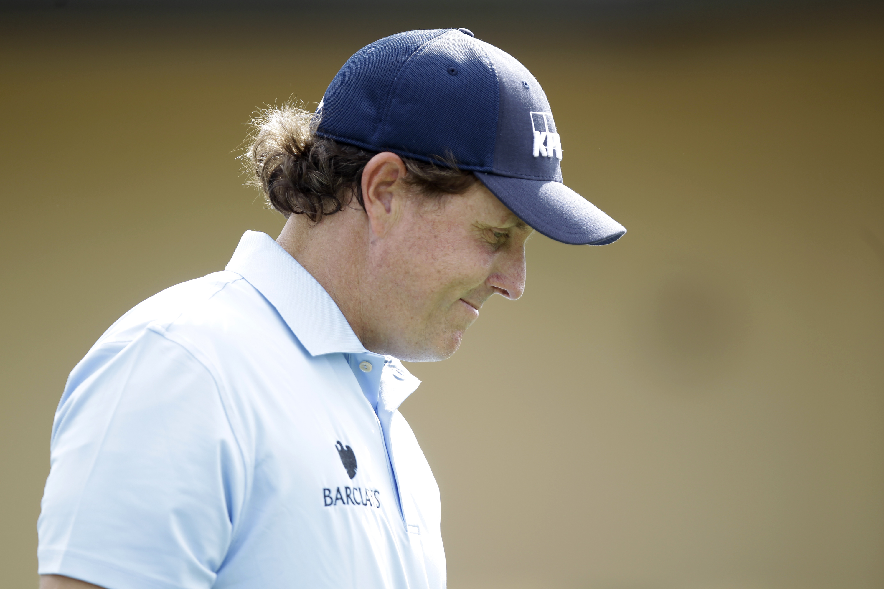 Phil Mickelson leaves the first tee during the third round of the Honda Classic