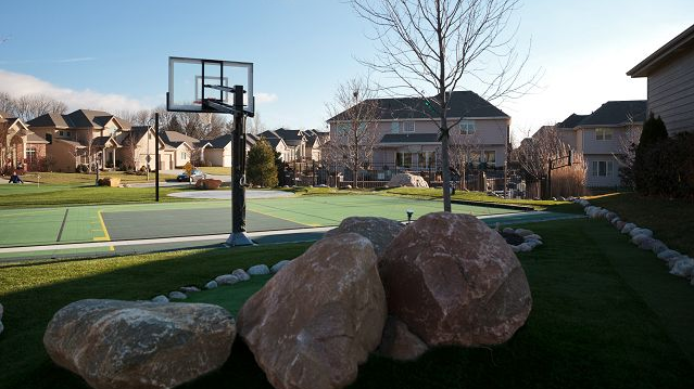 A view of Marsh's half-court sports court on the extra lot adjacent to his home in Fire Ridge.